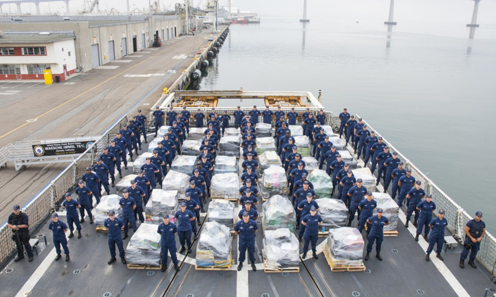 Crewmembers pose with the confiscated drugs on the deck of the Coast Guard Cutter Waesche in San Diego Thursday.