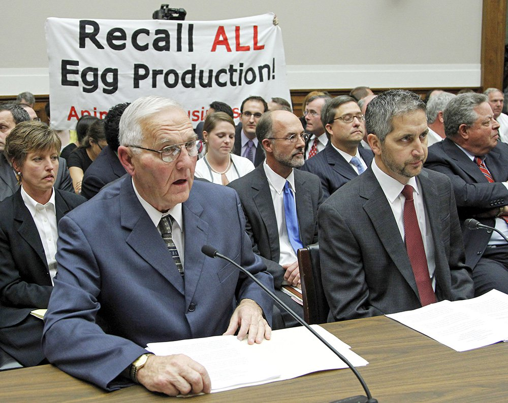 Jack DeCoster, left, and his son Peter DeCoster testify before the House Oversight and Investigations subcommittee in 2010 on a salmonella outbreak in eggs.