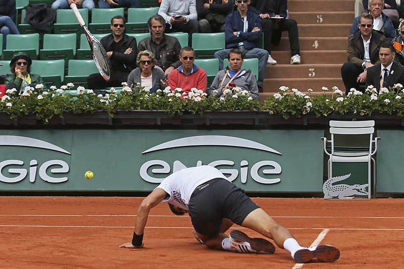 Serbia's Novak Djokovic slips in his quarterfinal match of the French Open tennis tournament against Austria's Dominic Thiem.