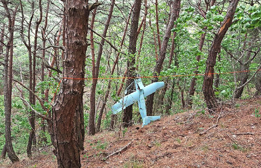 In this Friday, June 9, 2017 photo provided by South Korean Defense Ministry on Tuesday, June 13, 2017, a suspected North Korean drone is seen in a mountain in Inje, South Korea. South Korean Defense Ministry said on Tuesday, June 13, 2017, the suspected North Korean drone found near the Korean border was found to have taken photos of a U.S. missile defense shield in the South. Investigators discovered hundreds of photos from the drone's Sony-made in-built camera. (South Korean Defense Ministry via AP)