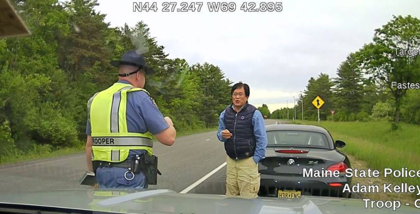 This dashcam image from Trooper Adam Kelley's cruiser shows Sang Yook, 64, who police say got out of his car to ask for a break and refused to get back in.  He was arrested for criminal speed and the 2014 BMW Z-4 was towed.