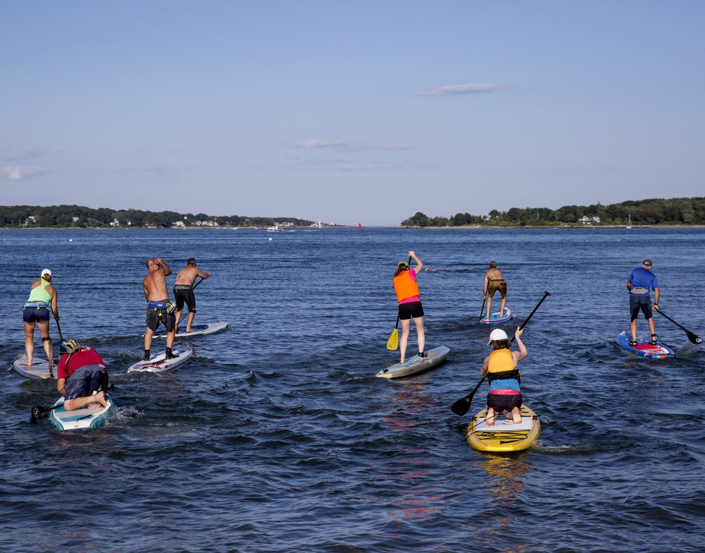 Stand-up paddle boarders can be seen in lakes and ocean waters throughout Maine. There are even races, like this one last August where competitors left from Willard Beach in South Portland and paddled to Ship's Cove at Fort Williams. But before you think about racing, it's time to work on the fundamentals.