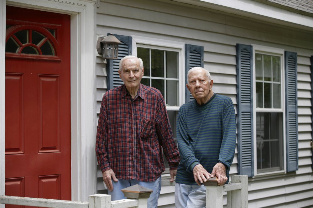 "Richard Perkins, right, and Robert Maurais stand outside their home in Ogunquit. Politicians have been chipping away at funding for heating aid to low-income Americans for a decade. Now President Trump has proposed ending it altogether, eliciting an outcry from low-income residents who depend on the program to stay warm. Perkins called the proposed elimination of heating aid ""cruel."""