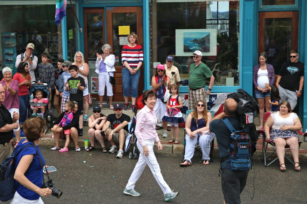 """Sen. Susan Collins, R-Maine, marches in Eastport's parade Tuesday. """"There was only one issue,"""" she said, of her constituents' focus on health care."""