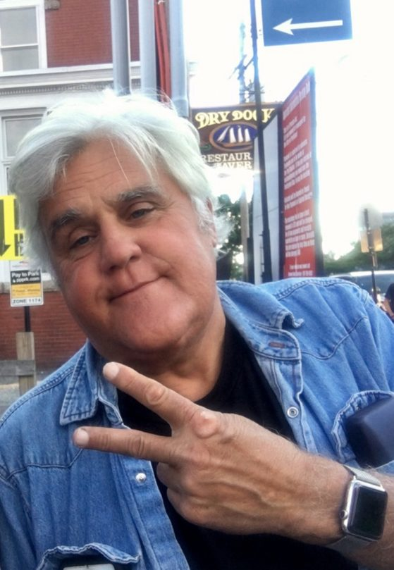 Comedian and car buff Jay Leno poses Tuesday for a picture on Commercial Street in Portland.