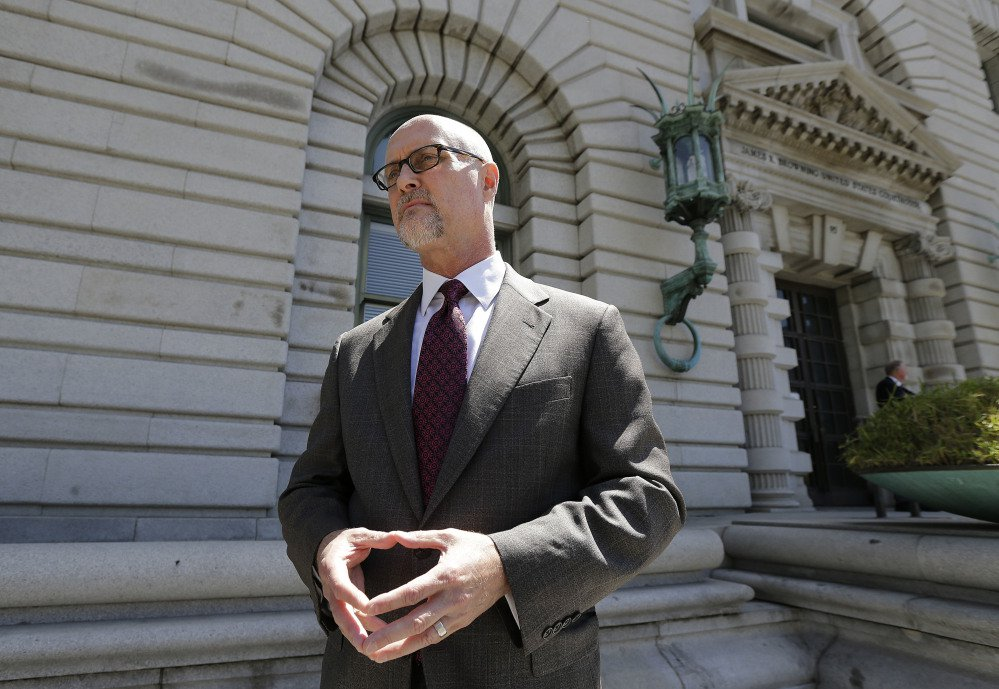 Jeffrey Kerr, general counsel to the People for the Ethical Treatment of Animals (PETA), speaks to reporters outside of the 9th U.S. Circuit Court of Appeals in San Francisco, Wednesday, July 12, 2017. Attorneys for David Slater, a wildlife photographer whose camera was used by a monkey to snap selfies, asked a federal appeals court to end a lawsuit seeking to give the animal rights to the photos. PETA sought a court order in 2015 allowing it to administer all proceeds from the photos to benefit the monkey. (AP Photo/Jeff Chiu)