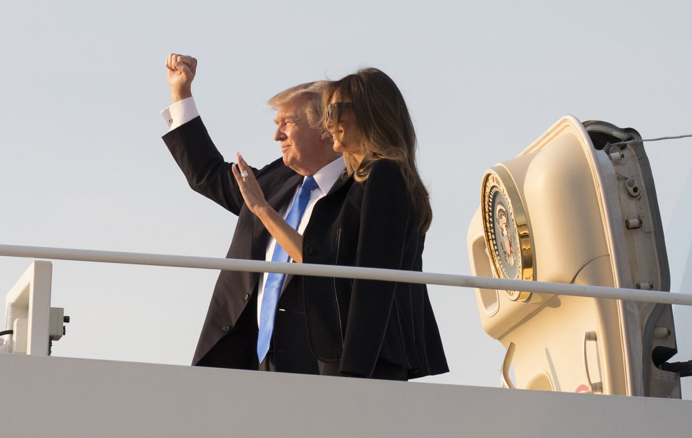 President Trump and first lady Melania Trump board Air Force One at Andrews Air Force Base, Md., en route to Paris for meetings meant to deepen ties that bind the U.S. and France.