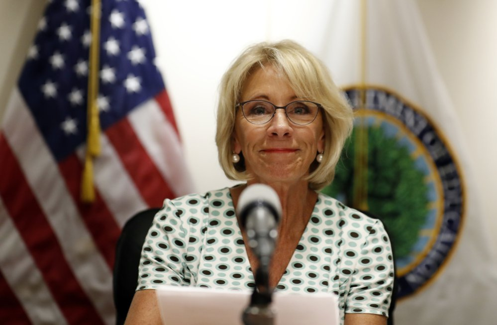 Education Secretary Betsy DeVos prepares to speak with reporters Thursday in Washington.