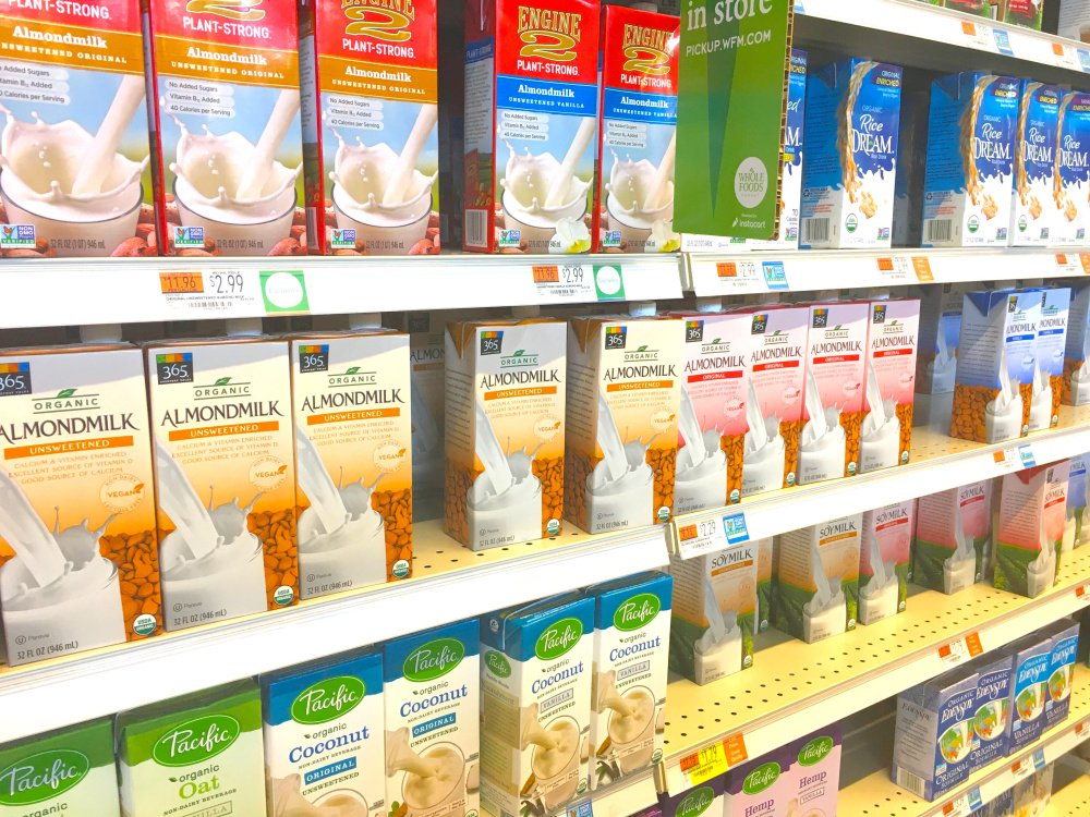 "The word ""milk"" appears on many plant-based beverages at the Portland Whole Foods Market."