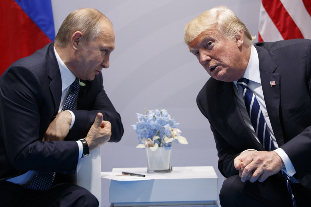 President Trump meets with Russian President Vladimir Putin at the G-20 summit on July 7 in Hamburg. The two also had a previously undisclosed hourlong conversation at the summit, a White House spokesman says.