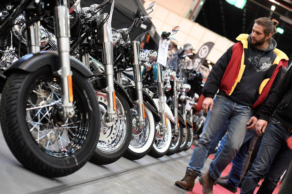 Harley-Davidson bikes are shown at a bike fair in Hamburg, Germany, in February. The company is cutting jobs as young Americans buy fewer bikes than baby boomers did.