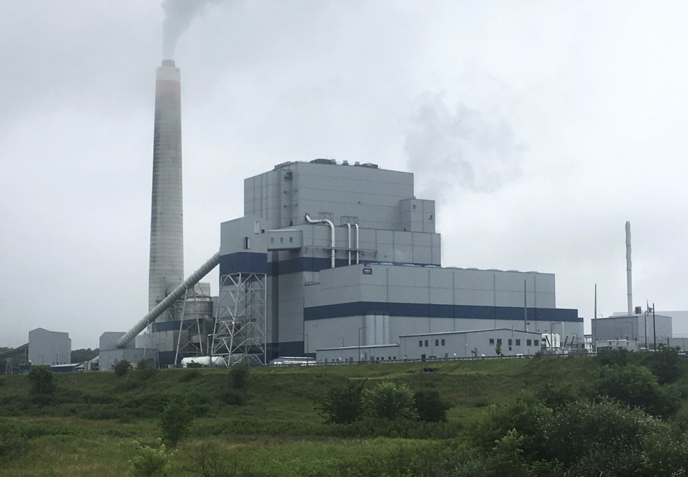 FILE - In this July 6, 2017, file photo, the Longview Power Plant in Maidsville, W.Va. The House voted July 18, 2017, to pass a Republican-backed bill delaying implementation of Obama-era reductions in smog-causing air pollutants. Congress voted 229 to 199 to approve the Ozone Standards Implementation Act of 2017. The measure delays by another eight years implementation of 2015 air pollution standards issued by the Environmental Protection Agency under the prior administration.(AP Photo/Michael Virtanen, File)