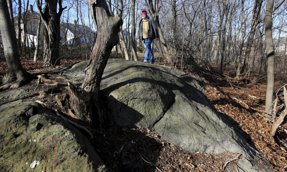 Salem State University history professor Emerson Baker walks through an area known as Proctor's Ledge in 2016. He and a team of researchers concluded it is the exact site where innocent people were hanged during the 1692 witch trials in Salem, Mass.