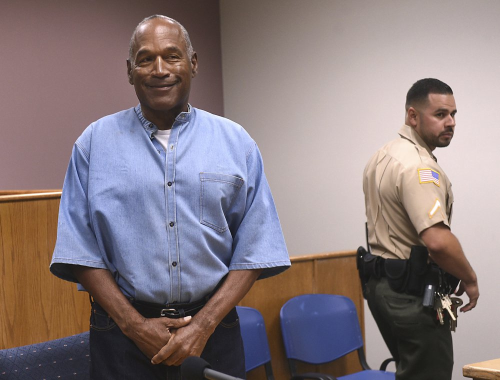 Former NFL football star O.J. Simpson enters his parole hearing at the Lovelock Correctional Center in Lovelock, Nev., on Thursday.