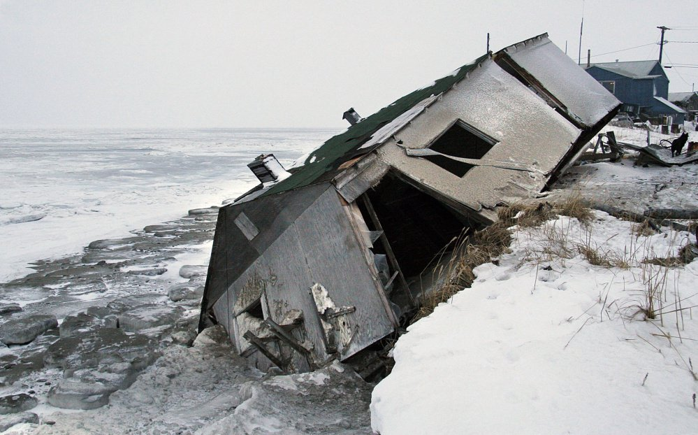 "In his op-ed published last week in The Washington Post, Joel Clement, who has been reassigned from his post as director of the Department of the Interior's Office of Policy Analysis, wrote that several of Alaska's Native communities – including Shishmaref, above, where a 2005 storm wreaked havoc – are ""perilously close to melting into the Arctic Ocean."" Find a link to his op-ed at pressherald.com."