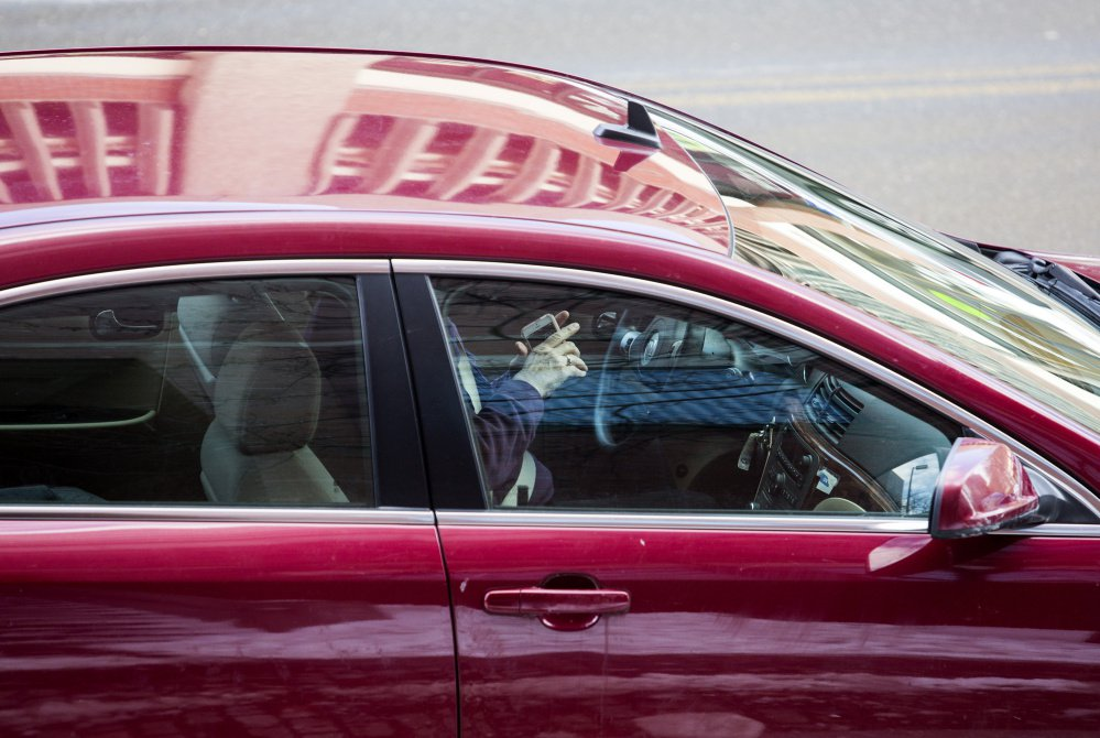 Smartphones and other handheld devices will be outlawed behind the wheel if the governor signs the legislation. If enacted, it will become law 90 days after the legislative session ends.