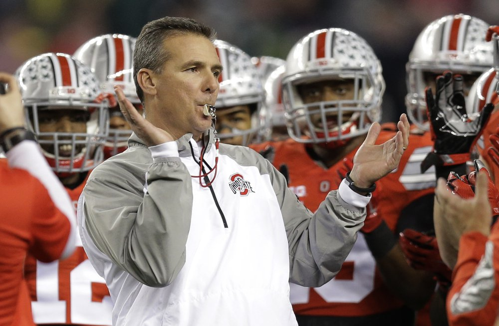 Ohio State head coach Urban Meyer rallies his players before the NCAA college football playoff championship game in 2015.