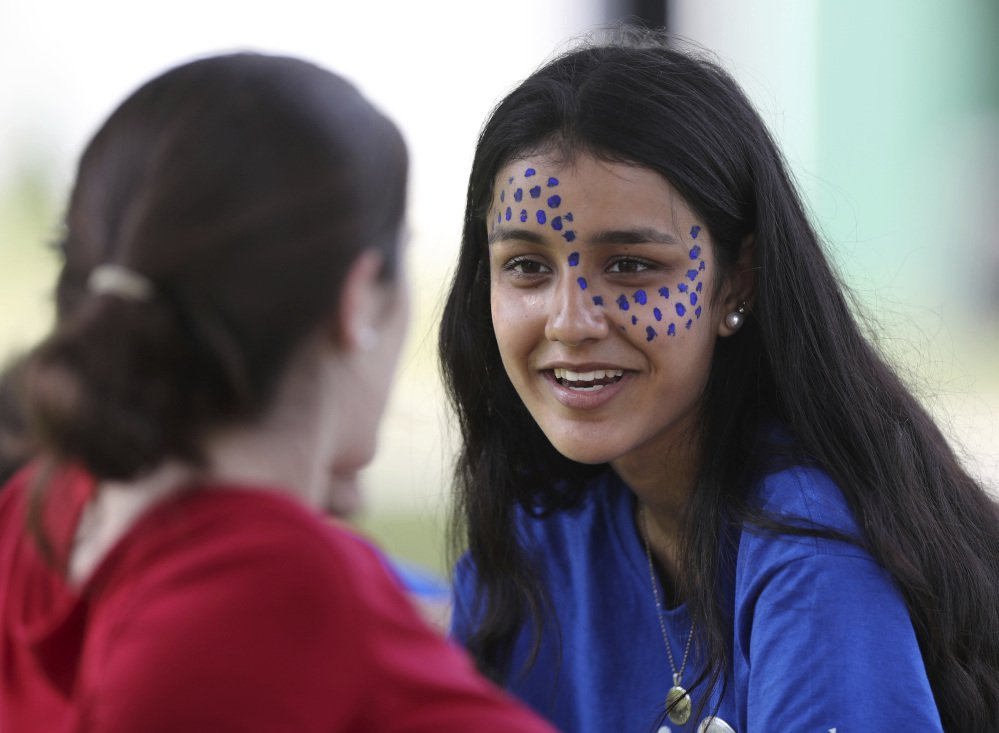 A camper from Pakistan, right, talks with an American at the Seeds of Peace camp in Otisfield.