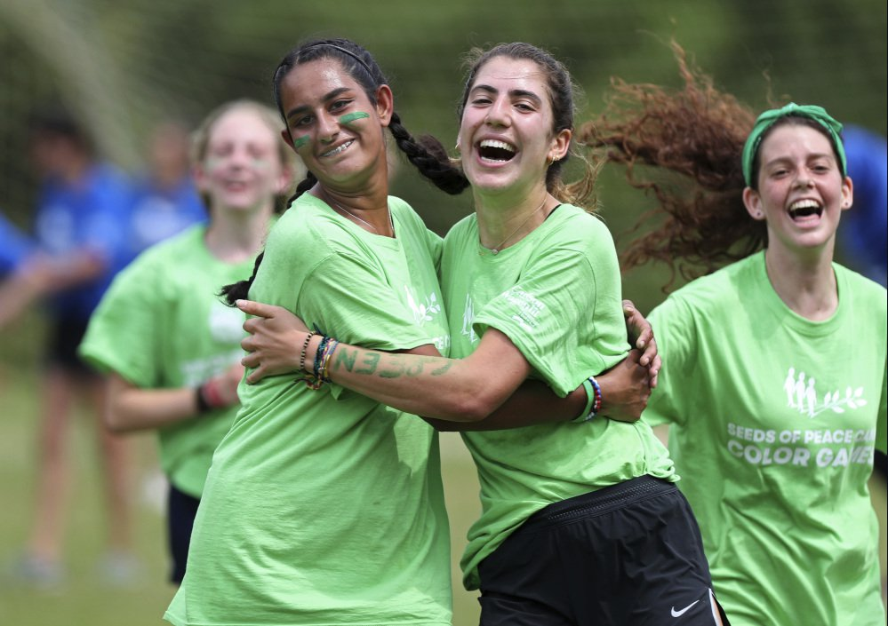 U.S. and U.K. campers celebrate a soccer goal at the Seeds of Peace camp.