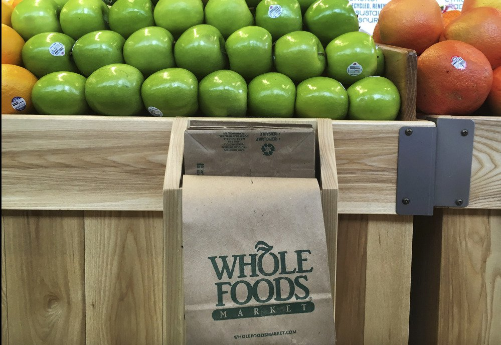 The upscale grocer has been battered in recent years by intense competition from traditional retailers such as Kroger and Wal-Mart that have expanded their organic offerings.