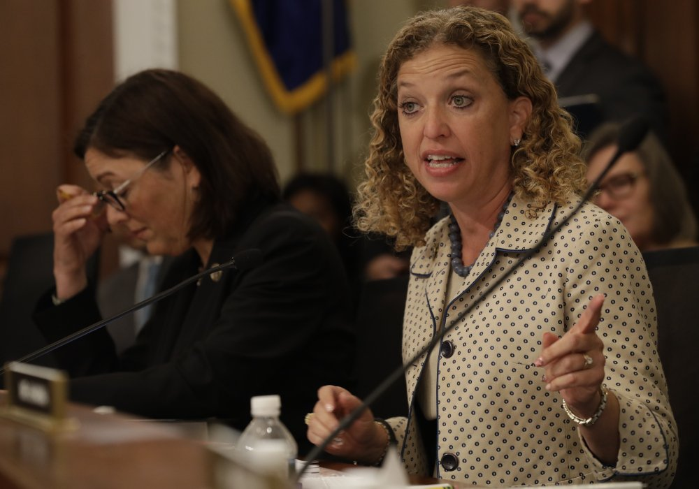 House Budget Committee member Rep. Debbie Wasserman Schultz, D-Fla., shown during a recent committee meeting next to Rep. Susan DelBene, D-Wash., says she delayed taking previous action against Imran Awan over concerns of due process and potential ethnic and religious profiling.