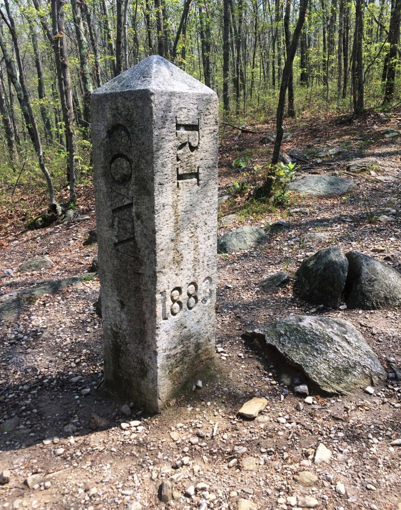 "An obelisk marks where Connecticut, Massachusetts and Rhode Island meet in Thompson, Conn. ""As soon as you see that thing, you're hooked,"" Brian Butler said."