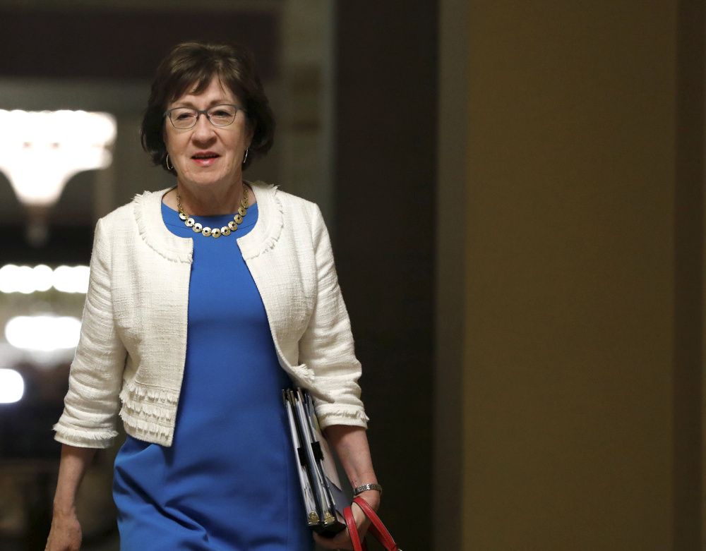Senator Susan Collins walks to the Senate floor before a vote on the health care bill on Capitol Hill in Washington late Thursday night, July 27.