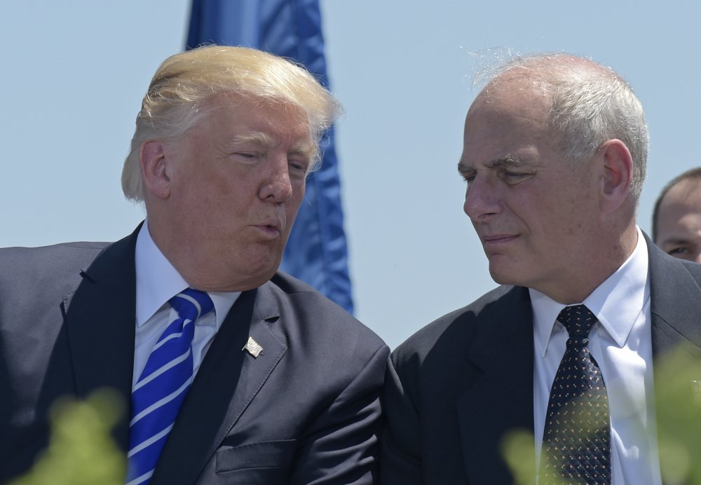President  Trump talks with Homeland Security Secretary John Kelly in May. Trump named Kelly as his new chief of staff, ousting Reince Priebus.