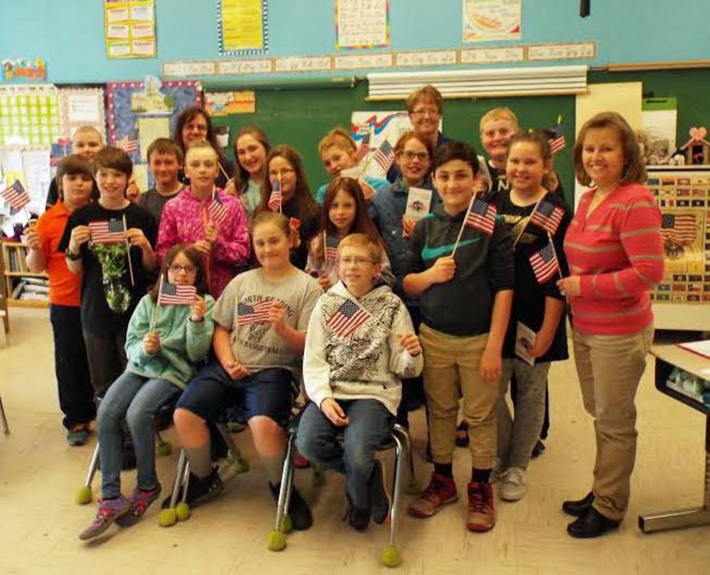 Liberty Day presentation participants, front from left, are Riley Trask, Jaydn Pingree, Jonah Moore and Caden Adams. Second row, from left, are Joseph Christian, Aubrey Kachnovich, Mia Henry, Avalyn Roy, Miranda Smiley, Kathryn Dorey and Susan Sandler, teacher. Third row, from left, are Ben Simard, Ares Ayer, Ian York, Rep. Tina Riley, Leah Burgess, Izzabella Curtis, Lyn Jellison and Robbie Bamford.