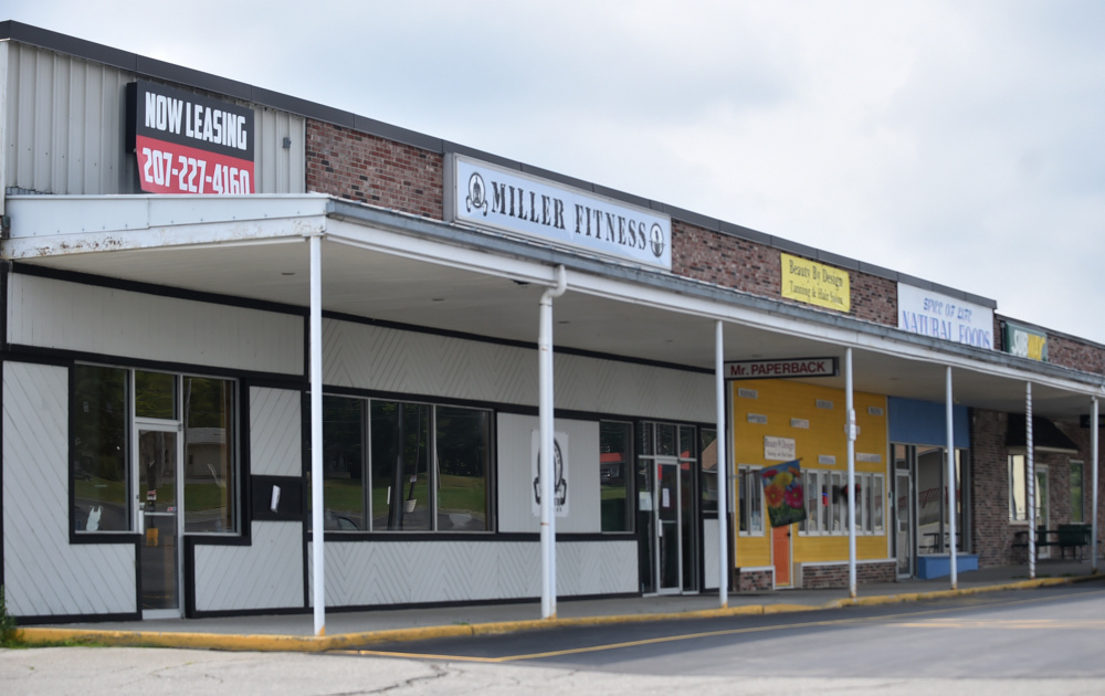 A vacant space borders Miller Fitness on Friday at the Skowhegan Plaza.