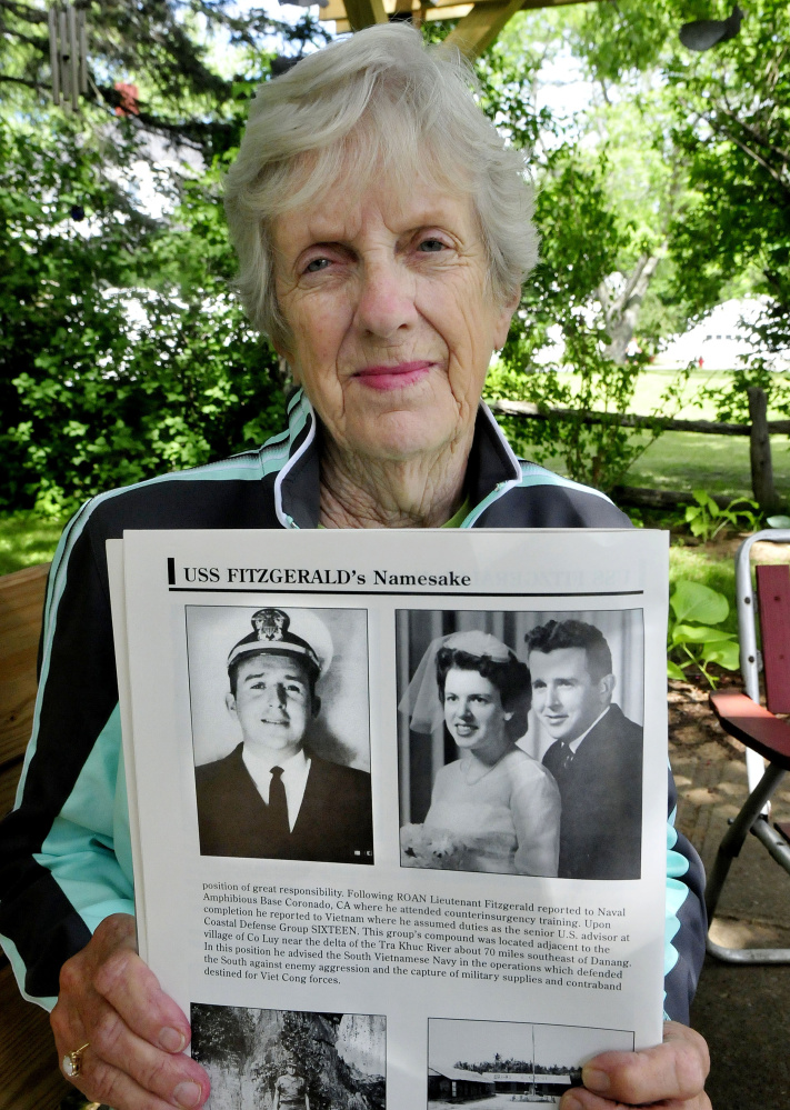 Evalyn Bowman of Skowhegan on Tuesday holds photos of her friend William Fitzgerald, who she attended school with in Vermont, and his wife, Betty. Bill Fitzgerald died during the Vietnam War. The Arleigh-Burke class destroyer USS Fitzgerald, named after him, was seriously damaged in a collision with a cargo ship near Japan earlier this month.