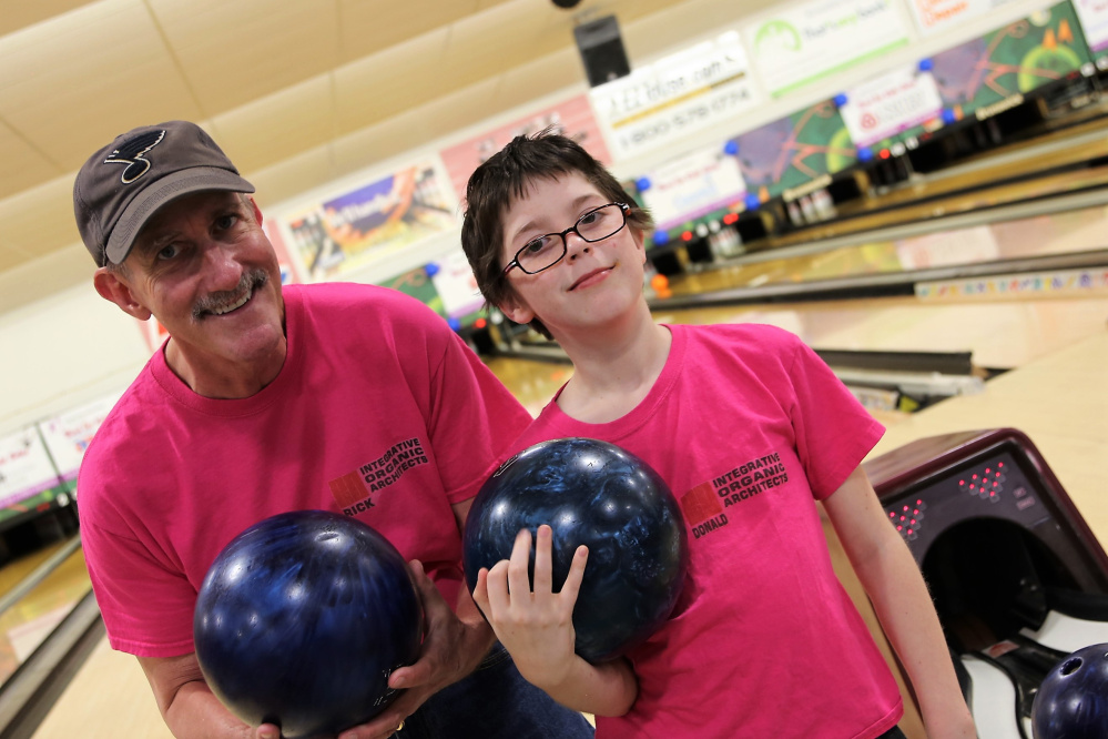 Big Brother Rick Eskelund and his Little Brother Donald Riopelle team up to Bowl for Kids' Sake at Sparetime Recreation in Hallowell May 6. Eskelund was the event's highest individual fundraiser, collecting $1,570 in pledges to support Big Brothers Big Sisters of Mid-Maine which matched them two years ago.