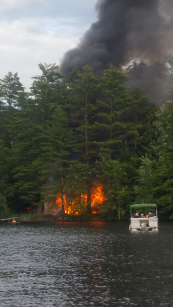 Fire destroys a guest cottage Tuesday on the the west shore of Maranacook Lake in Readfield. Fire officials saif Wednesday the blaze was an accident.