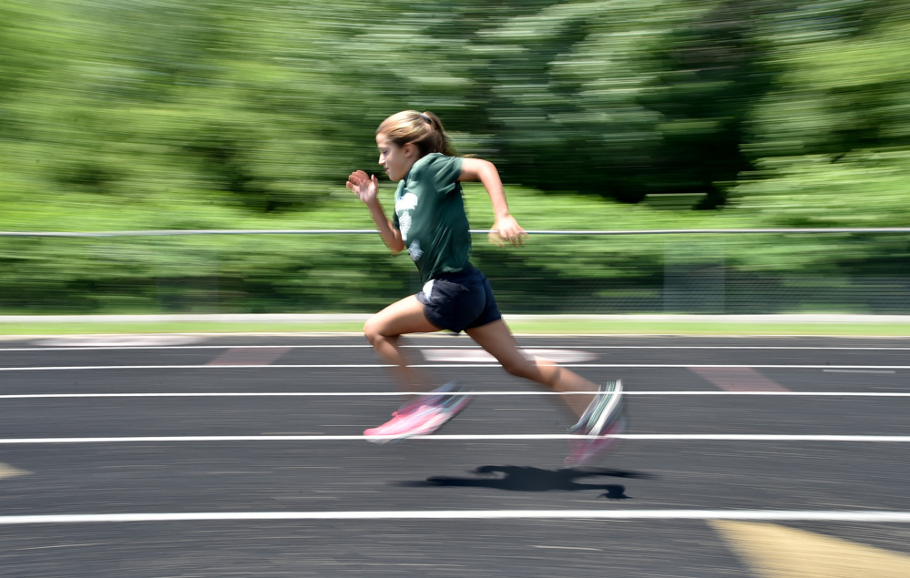 Winthrop's Georgette Brown competes in the 200-meter dash at a youth summer track meet Thursday at Winslow High School.