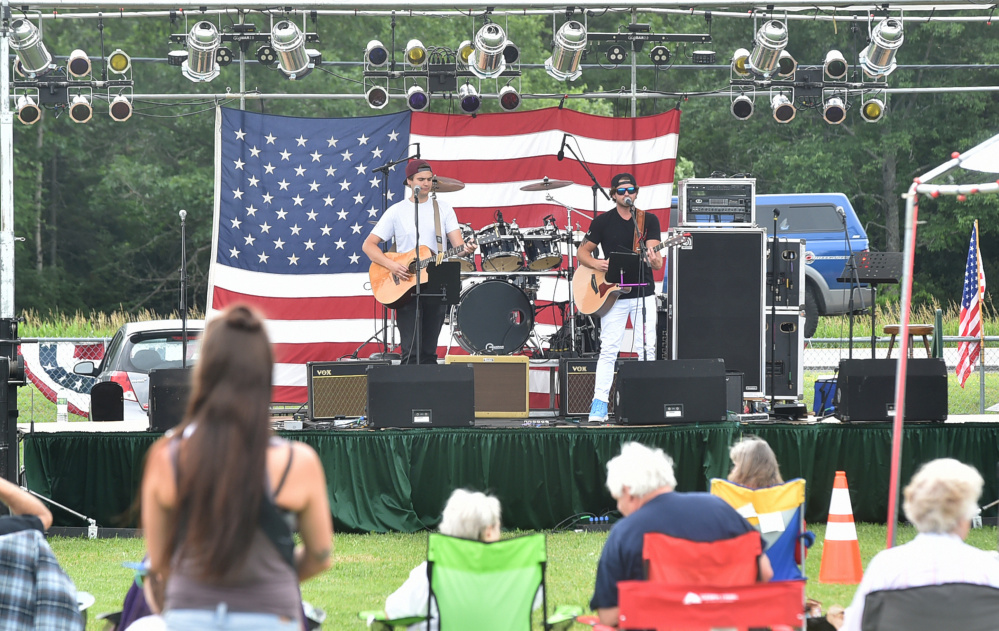Dylan Brann and Nick Colizzi perform on Tuesday at the Central Maine 4th of July Celebration in Clinton.