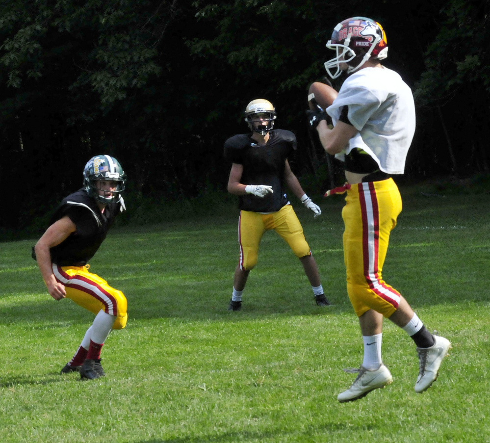 Staff photo by David Leaming East receiver Josh Buker makes a catch during Lobster Bowl practice Tuesday at Dover-Foxcroft.