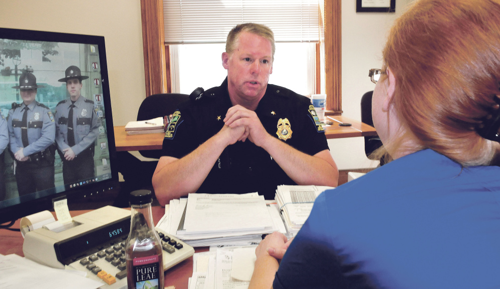 Skowhegan police Officer David Bucknam speaks with Town Manager Christine Armand on Tuesday in her office. Bucknam has been appointed the town's new police chief.