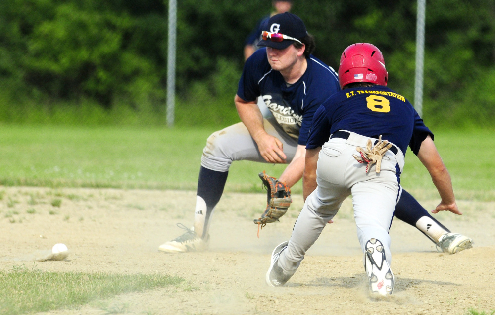 Gardiner infielder Ryan Kappelmann, left, waits for a throw as Augusta baserunner Justin Rodrigue slides safely into second during an American Legion Zone 2 game against Gardiner on Tuesday at Hoch Field in Gardiner.