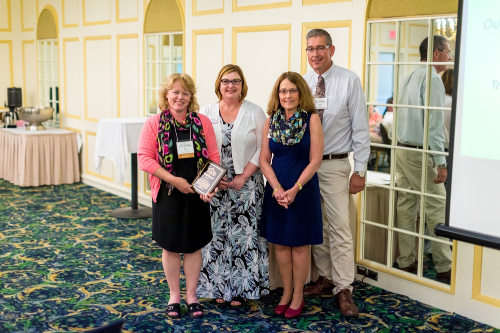 Transformational Clinical Collaboration Award Winner Jodi Beck, RN. From left are Beck, Carla Stockdale, Cheryl Davis and Scott Brown.