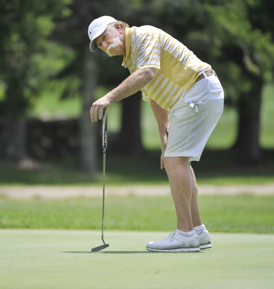 Mark Plummer watches one of his putts roll past a hole during the second round of the 98th Maine Amateur on Wednesday in Brunswick. A 13-time tournament champ, Plummer failed to make the cut for the final round Thursday.