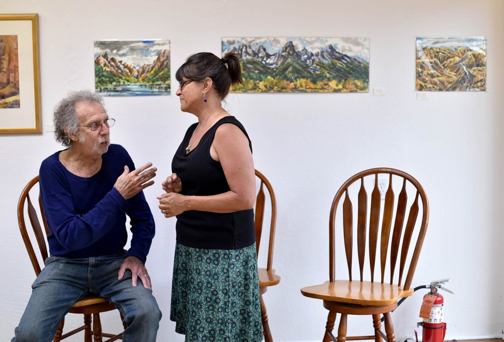 Christy Whitmore, center, greets Stu Silverstein, of Solon, at a Wednesday gathering of artists at Skowhegan's newest art venue, Fourteen Madison, to plan Wesserunsett Arts Council's annual Open Studio Tour, which will be held Aug. 12 this year, and not in October as in previous years.