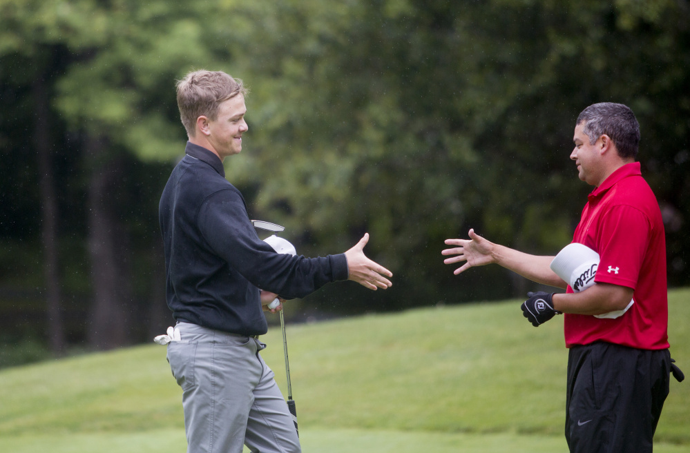 Jack Wyman, left, shakes hands with Joe Alvarez after the final round of the Maine Amateur golf tournament Thursday at the Brunswick Golf Club. Wyman, of South Freeport, who plays out of the Portland Country Club, won the tournament. He is the first left-handed player to ever win in the tournament.