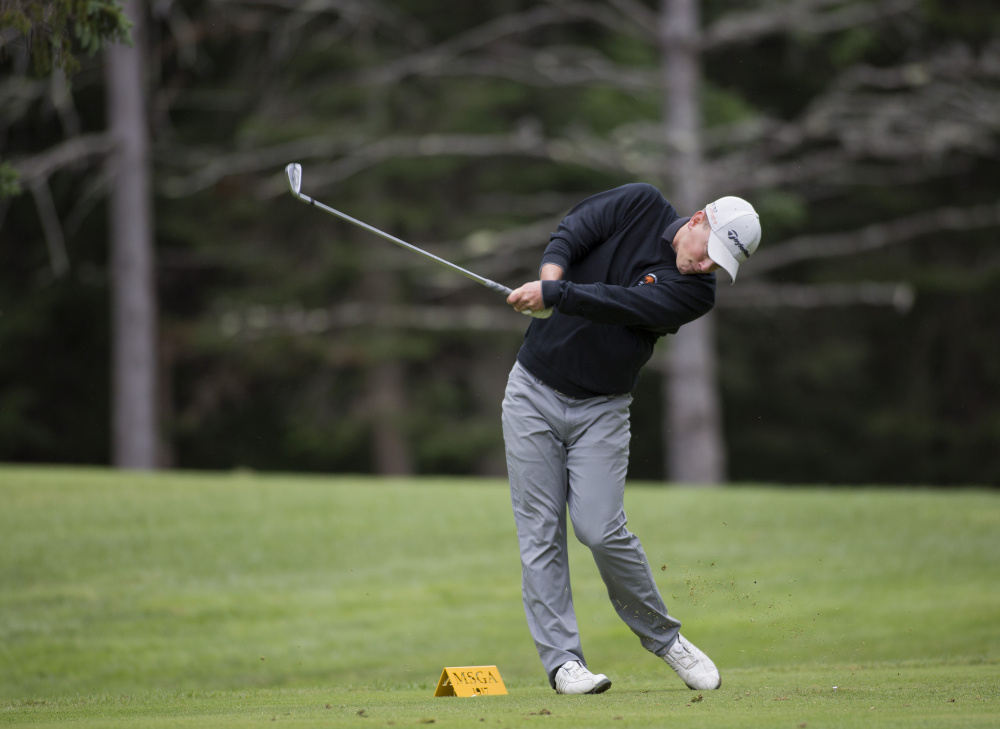 Jack Wyman hits the ball during the final round at the Maine Amateur golf tournament at the Brunswick Golf Club on Thursday. Wyman, of South Freeport, who plays out of the Portland Country Club, won the tournament. He is the first left-handed player to ever win in the tournament.