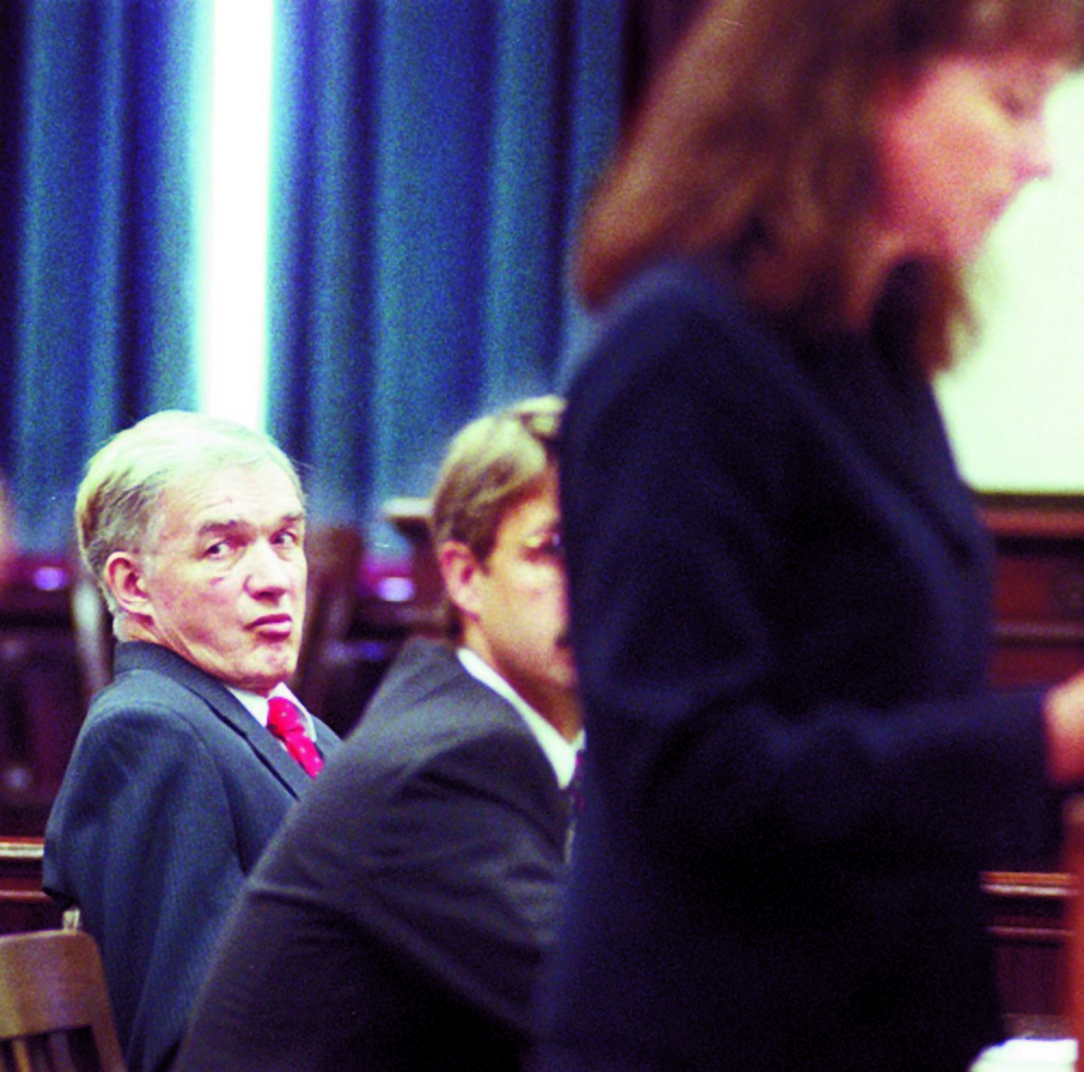 Albert Cochran, left, listens during a September 1998 court hearing on his murder change at Somerset County court in Skowhegan. Next to him are defense lawyers John Pelletier and Michaela Murphy at podium. Police are searching wells in central Maine for the remains of Pauline Rourke, Cochran's live-in girlfriend, who disappeared two weeks after Janet Baxter was murdered in 1976.