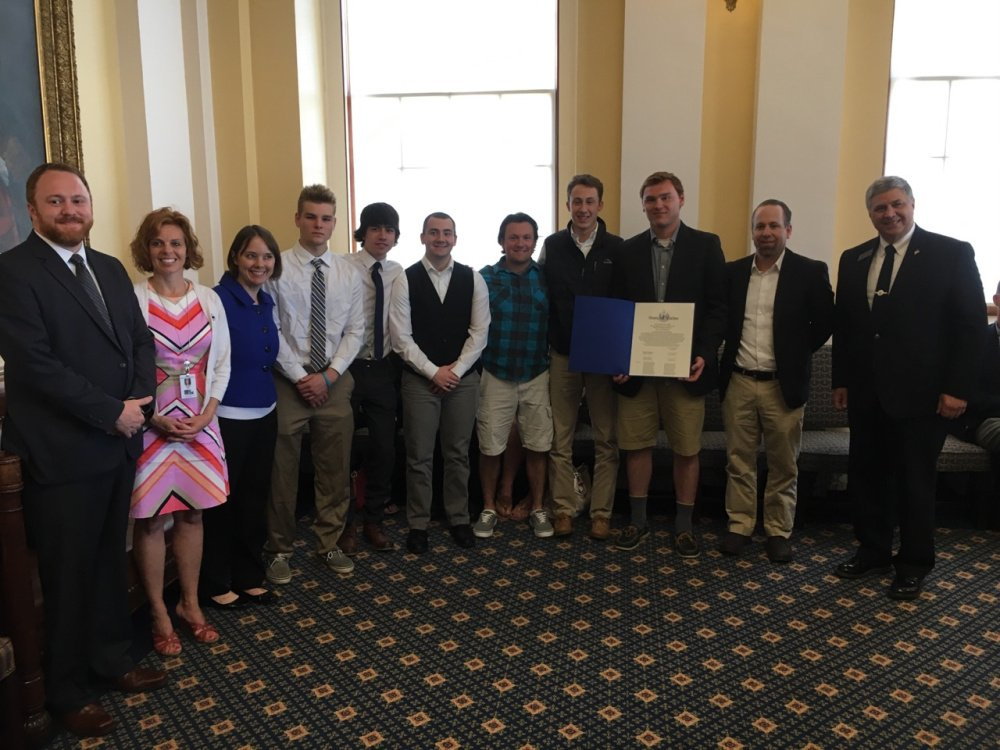 The Maine Senate recognized the Maine Moose U18 team, based in Hallowell, on June 14 for their victory at the 2017 Tier 2A USA National Hockey Championship in Lansing, Michigan. From left are Sen. Nate Libby, D-Lewiston; Sen. Amy Volk, R-Scarborough; Sen. Shenna Bellows, D-Manchester; Jeromy Rancourt, Tanner McClure, Matthew Deveaux, Tyler Wheeler, Thomas Arps, Gavin Bates, Coach Jeff Ross and Sen. Scott Cyrway, R-Benton.