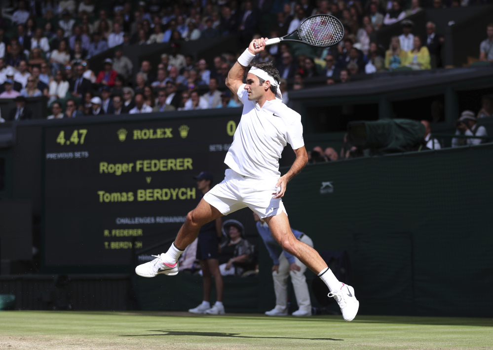 Roger Federer returns to Tomas Berdych during their Wimbledon semifinal match Friday in London.