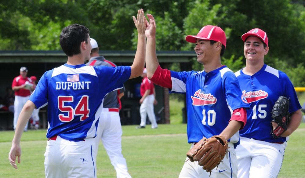 Augusta's Logan Dupont, left, Akira Warren (10) and Luke Anderson celebrate a 5-0 victory over South Portland in a 14U Babe Ruth All-Star game Friday at McGuire Field in Augusta.