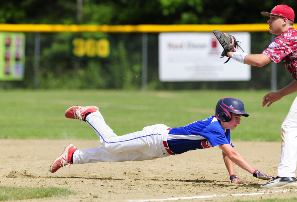 Augusta's Kyle Douin dives safely back to first base as South Portland first baseman Tyler Small waits for the throw during a 14U Babe Ruth All-Star game at McGuire Field on Friday in Augusta.
