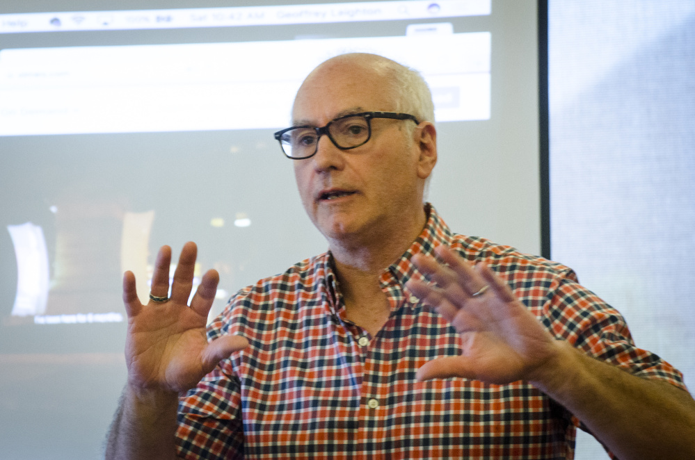 Geoffrey Leighton, of Durham, a University of Southern Maine instructor, discusses activist visual art Saturday at a Maine International Film Festival workshop at the Waterville Public Library.