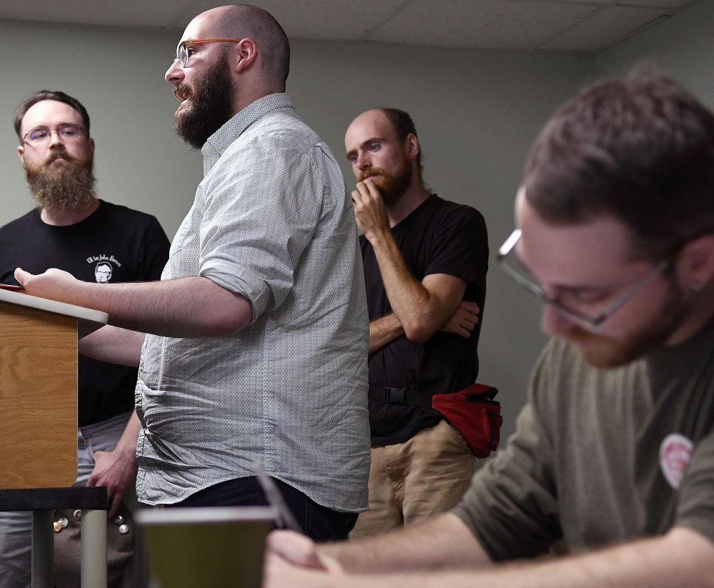 """Maine Socialist Party member Jeremy Claywell, right, takes notes Sunday of a presentation by members of the Maine John Brown Gun Club during a statewide meeting of Maine socialists in Augusta. The Gun Club's Facebook page describes themselves as """"the Maine branch of Redneck Revolt. We're anti-racist, anti-capitalist working folks working in solidarity for liberty for all people."""""""